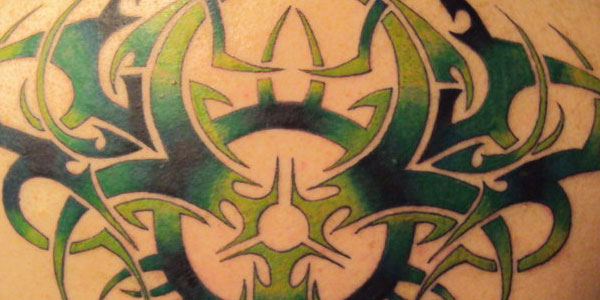 20 amazing tribal tattoos for men themescompany for Tribal biohazard tattoo designs